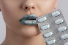 Sexy woman mouth with blister of pills Stock Image