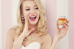 Sexy woman with muffin. Excited elegant woman with muffin Royalty Free Stock Image