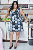 Sexy woman. Nice pretty sexy fat woman in kitchen Stock Photos
