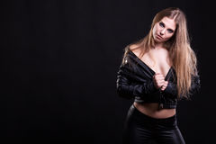 Sexy woman with no bra in leather jacket Stock Photography