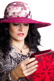 Woman Opening Present Stock Photography
