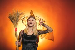 Woman on orange background. Background decorated for Halloween. Happy halloween. Halloween party and funny Pumpkin. Happy Halloween Quotes and Sayings. Magic stock images