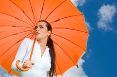 Sexy woman and orange umbrella Royalty Free Stock Image