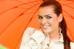 Sexy woman and orange umbrella Royalty Free Stock Photo