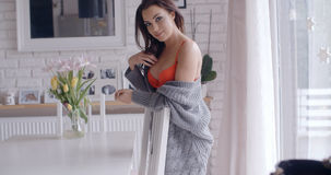 Sexy Woman in Orange Underwear with Cardigan Stock Photography
