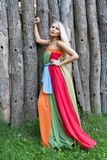 Sexy woman outdoor with nice colorful dress Stock Photo