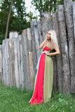Sexy woman outdoor with nice colorful dress Royalty Free Stock Image