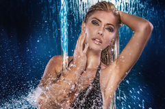 Sexy woman over water drops. Stock Photos