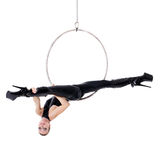 Sexy woman performance in latex catsuit on aerial hoop Royalty Free Stock Photos