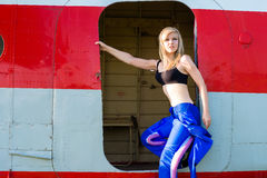 Sexy woman pilot in the door plane Stock Images