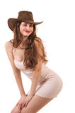 Sexy woman in pink dress and cowboy hat isolated on white backgr Royalty Free Stock Images