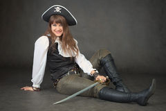 Sexy woman - pirate sits on black background Royalty Free Stock Images