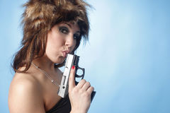 Sexy woman with pistol Stock Photography