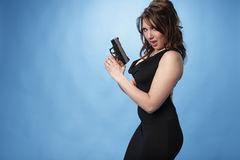 Sexy woman with pistol Royalty Free Stock Images