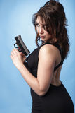 Sexy woman with pistol Stock Photo