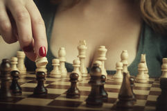 Sexy woman playing chess Stock Images