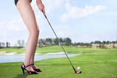 Sexy woman playing golf Royalty Free Stock Photography