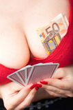 Sexy woman playing poker Stock Photo