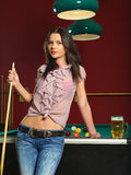 Sexy woman playing pool Stock Photos