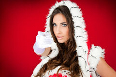 Sexy woman pointing in santa costume Royalty Free Stock Images