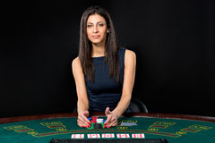 Sexy woman with poker cards and chips Stock Photo