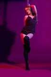 Sexy woman pole dancer performing on stage Stock Photography