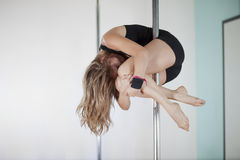 Sexy woman pole dancing Stock Image