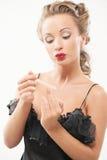 woman polishing fingernails Stock Images