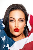 Sexy woman portrait covering with USA flag Royalty Free Stock Images