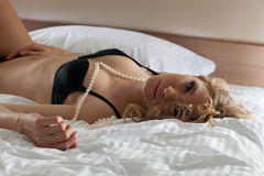 Sexy woman portrait with pearls in black lingerie Stock Image