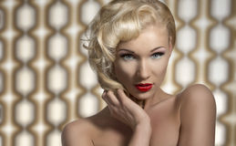 Woman posing as a diva. Portrait of vintage woman with retro make-up and hair-style, looks in camera and posing as a diva on 70 background royalty free stock image