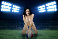 Sexy woman posing with a ball Royalty Free Stock Photography