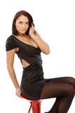 Sexy woman posing on barstool Stock Image
