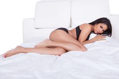 Sexy woman posing in bed Royalty Free Stock Photos