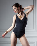 Sexy woman posing in black swimsuit in interior Royalty Free Stock Images