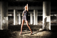 Sexy woman posing in dark industrial zone Royalty Free Stock Image