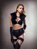 Sexy woman posing in erotic lingerie and fur Royalty Free Stock Photography