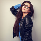 Sexy woman posing in fashion black leather jacket and eye glasse Royalty Free Stock Image