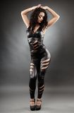 Sexy woman posing in leather suit. Full length portrait of a sexy woman posing in leather suit Royalty Free Stock Photo