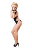 woman posing in swimsuit and fur-cap stock image