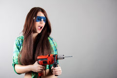 Woman with power drill. Portrait of woman with power drill stock photo