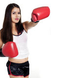 Sexy woman punching with boxing gloves Royalty Free Stock Photo