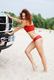 Sexy woman pushing the jeep Royalty Free Stock Photos