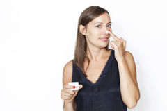 Sexy woman putting lotion on her face Royalty Free Stock Image