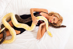 Sexy woman pythons Royalty Free Stock Image