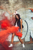 Sexy woman in rabbit ears waving red smoke bombs Royalty Free Stock Image