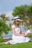 Sexy woman reading Royalty Free Stock Photos