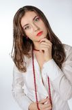 Woman with Red Bead Royalty Free Stock Image