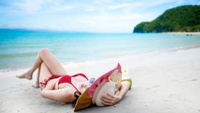Sexy woman in the red bikini on beach. Sexy woman in the red bikini and sunhat on sea beach.travel summer beach stock images