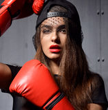 Sexy woman with red Boxing Gloves at the gym concept about sport Royalty Free Stock Image